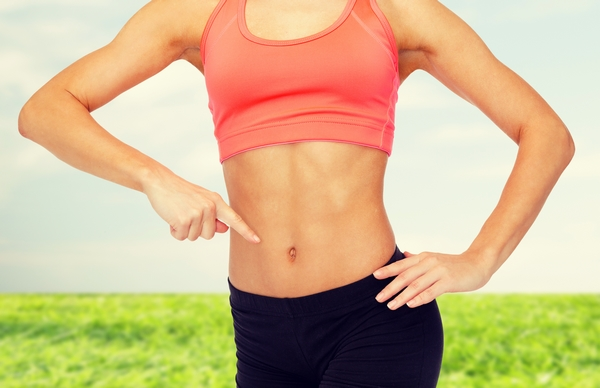 fitness, exercise and diet concept – close up of woman pointing